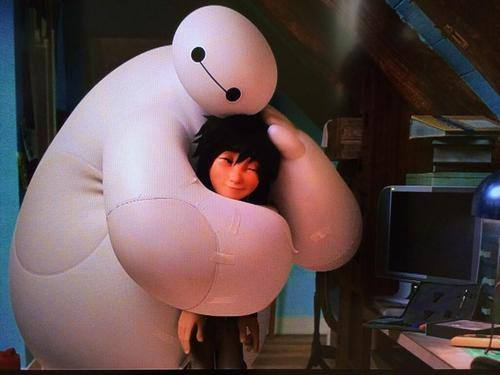 By then Baymax is already preparing the defibrillator