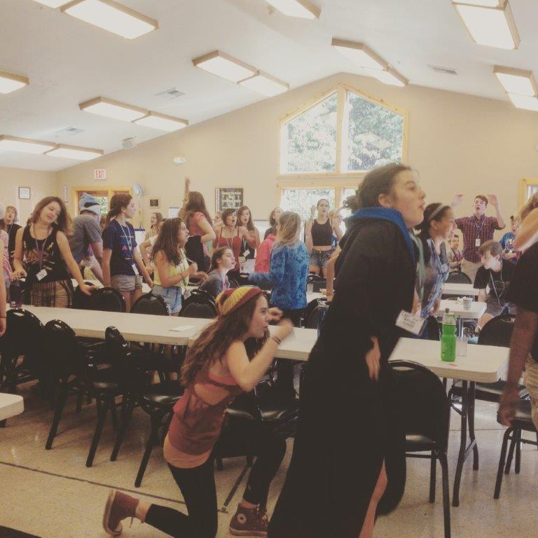 Announcements are followed by the YATC camp chant, including fun dance moves.